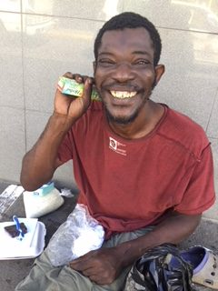 Bringing soap and toiletries to a street peron Making him very happy !